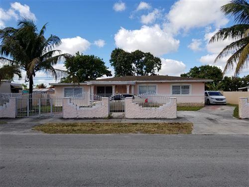 Photo of 1825 NW 129th Street, Miami, FL 33167 (MLS # RX-10630385)