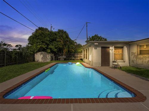 Photo of 5600 Souchak Drive, West Palm Beach, FL 33413 (MLS # RX-10741387)