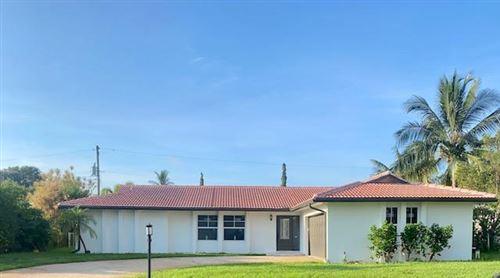 Photo of 1858 Crafton Road, North Palm Beach, FL 33408 (MLS # RX-10656388)
