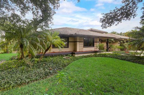Photo of 2735 Oak Tree Lane, Fort Lauderdale, FL 33309 (MLS # RX-10751389)