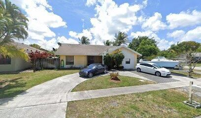 Photo of 7436 SW 12th Court, North Lauderdale, FL 33068 (MLS # RX-10750393)