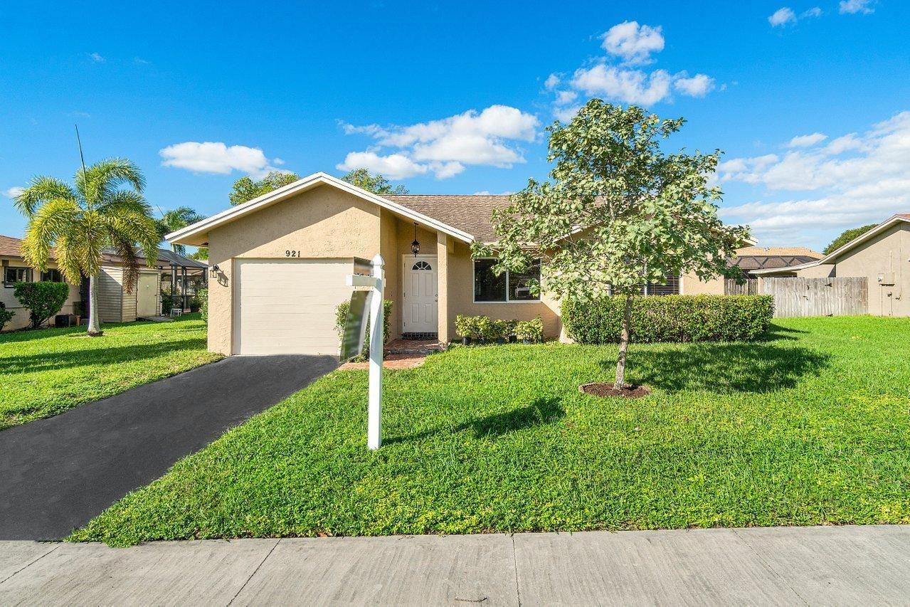 Photo of 921 NW 48th Avenue, Coconut Creek, FL 33063 (MLS # RX-10672394)