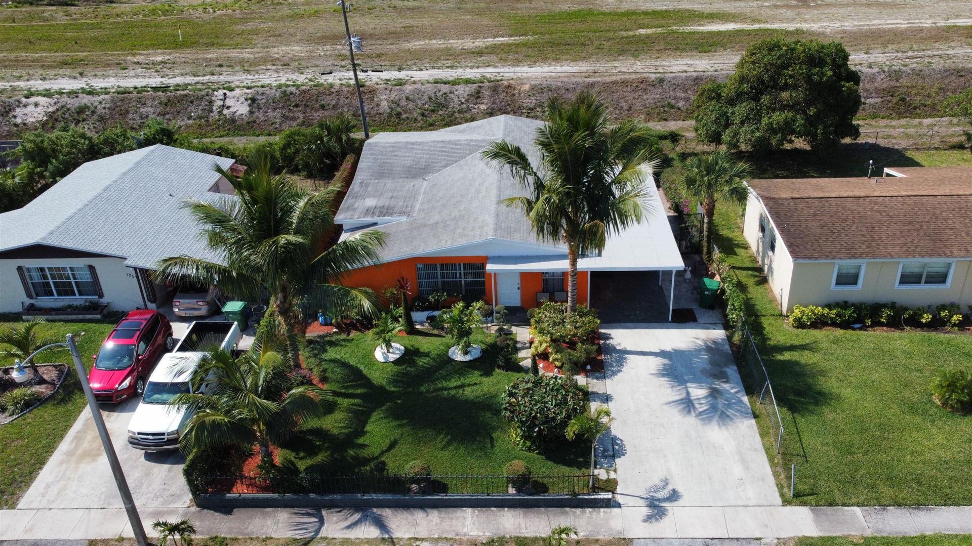 Photo of 1261 W 1st Street, Riviera Beach, FL 33404 (MLS # RX-10709396)
