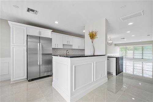 Photo of 1041 Orange Terrace #202, Delray Beach, FL 33445 (MLS # RX-10635397)
