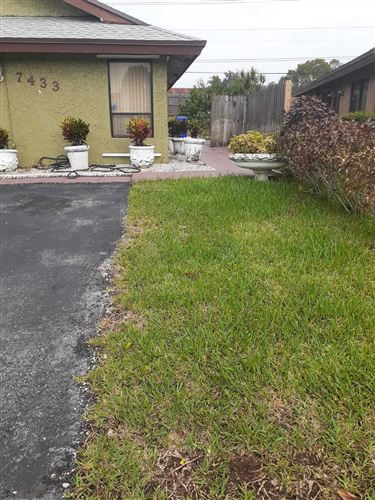 Photo of 7433 SW 11th Court, North Lauderdale, FL 33068 (MLS # RX-10670397)