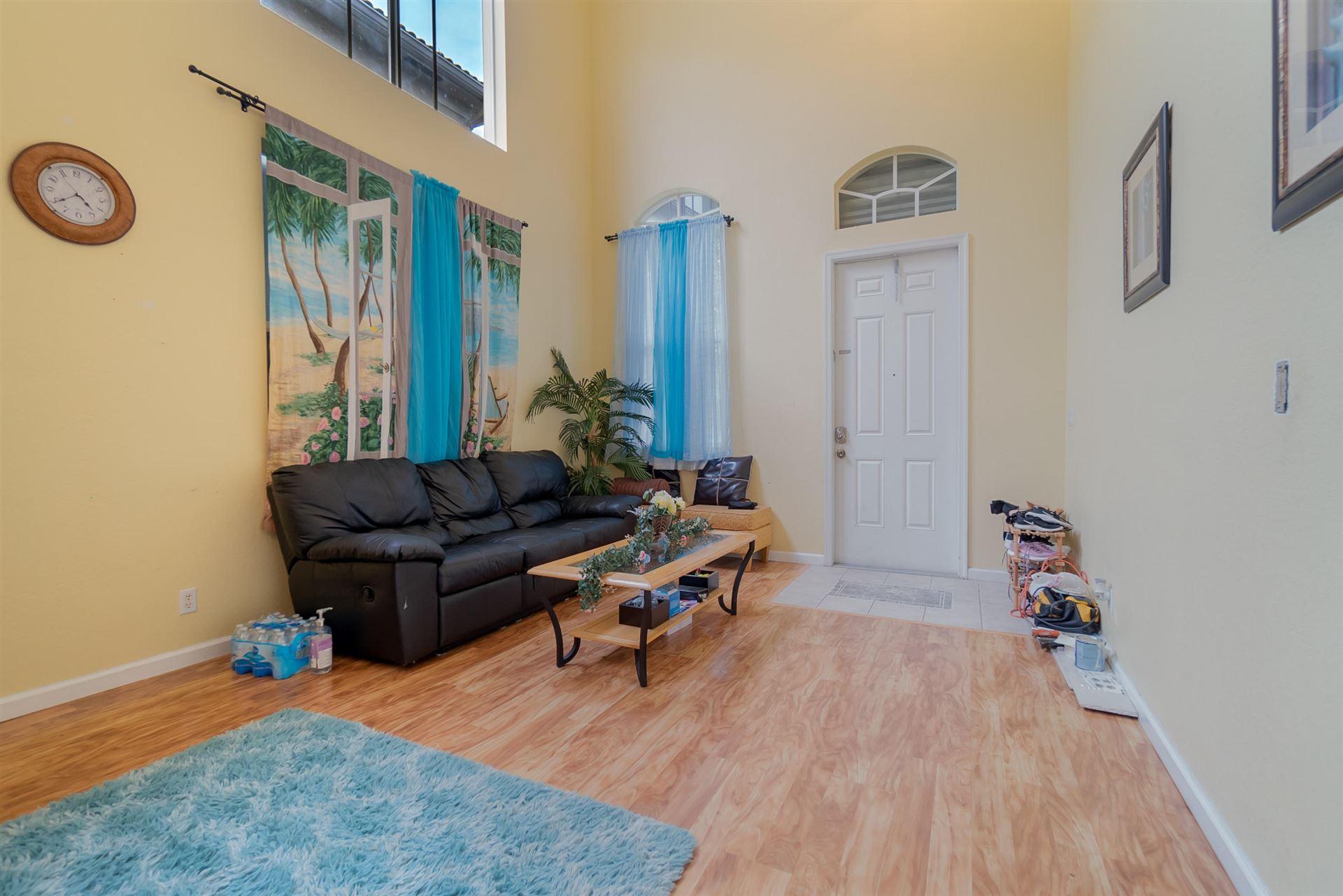 Photo of 1285 Rosegate Boulevard, Riviera Beach, FL 33404 (MLS # RX-10671397)