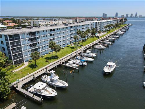 Photo of 108 Paradise Harbour Boulevard #201, North Palm Beach, FL 33408 (MLS # RX-10711400)
