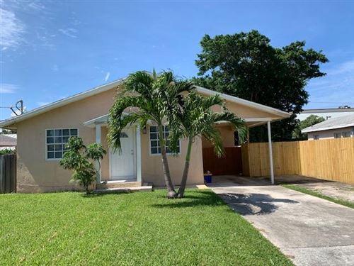 Photo of 1853 Holman Drive, North Palm Beach, FL 33408 (MLS # RX-10629404)