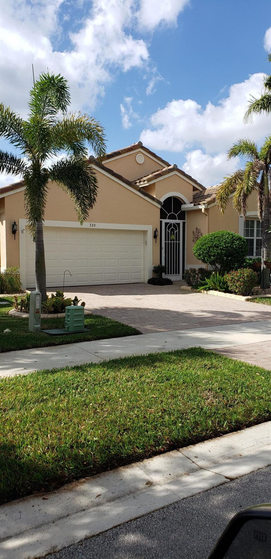 Photo of 329 NW Shoreview Drive, Port Saint Lucie, FL 34986 (MLS # RX-10700404)
