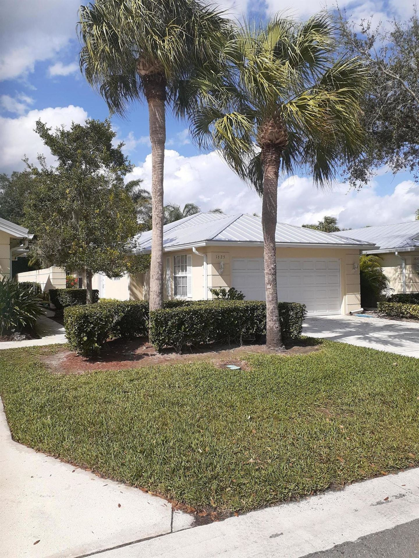 Photo of 1625 SW Waterfall Boulevard, Palm City, FL 34990 (MLS # RX-10692406)