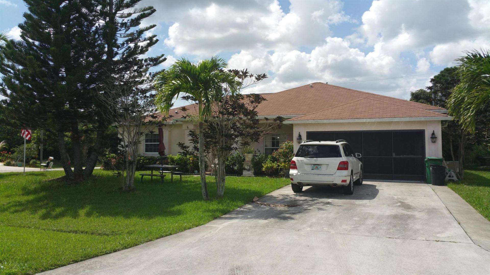 Photo of 473 SW Prater Avenue, Port Saint Lucie, FL 34953 (MLS # RX-10733406)