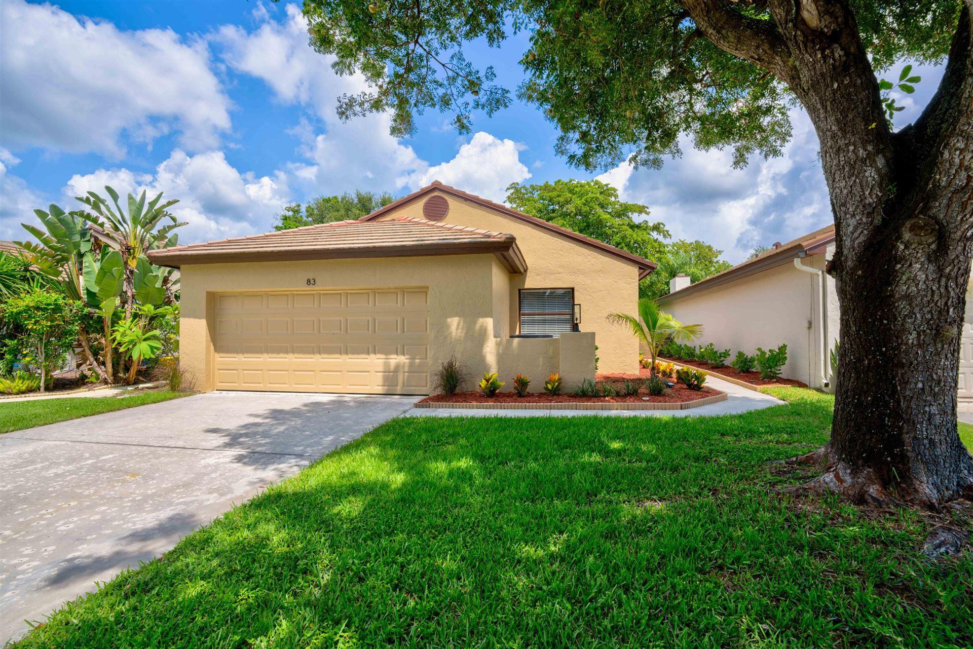 Photo of 83 Ironwood Way N, Palm Beach Gardens, FL 33418 (MLS # RX-10744412)