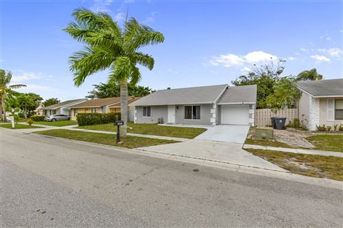 Photo of 6041 Triphammer Road, Lake Worth, FL 33463 (MLS # RX-10608414)