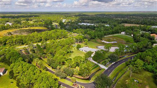 Photo of 2404 SE Ranch Acres Circle, Jupiter, FL 33478 (MLS # RX-10751417)