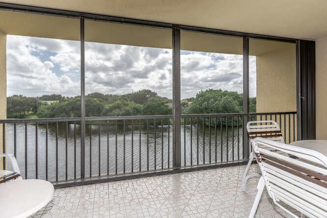 Photo of 5188 Woodland Lakes Drive #332, Palm Beach Gardens, FL 33418 (MLS # RX-10669417)