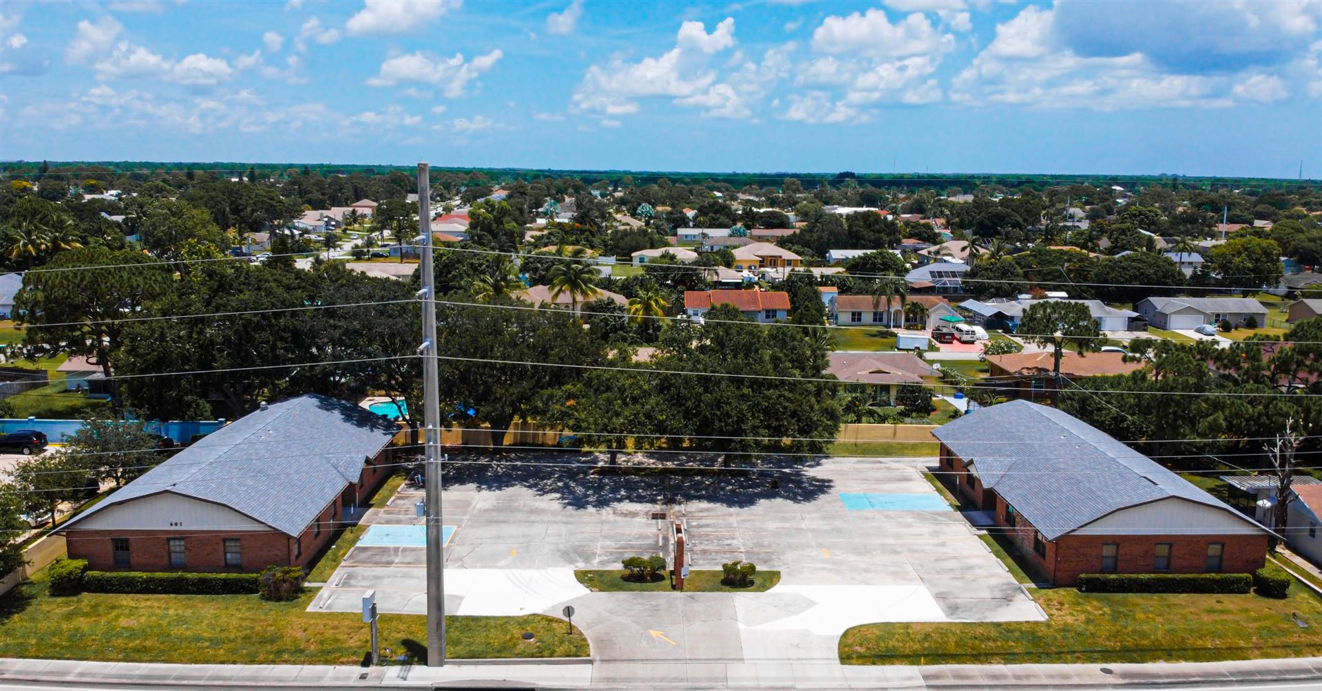 Photo of 601 SE Port St Lucie Boulevard, Port Saint Lucie, FL 34984 (MLS # RX-10704418)