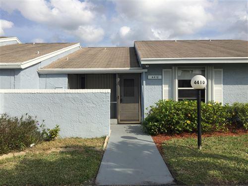 Photo of 4410 Lucerne Villas Lane, Lake Worth, FL 33467 (MLS # RX-10603432)