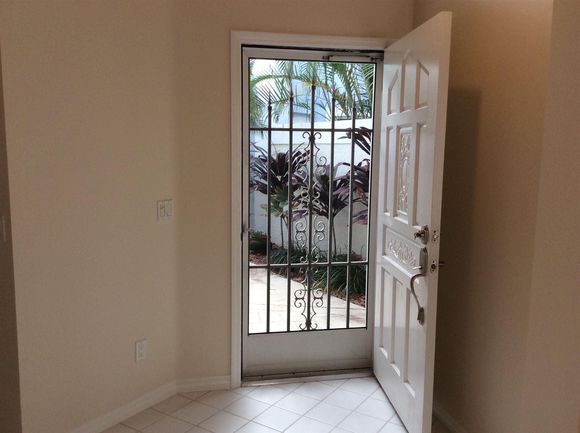 Photo of 6 Elgin Lane, Palm Beach Gardens, FL 33418 (MLS # RX-10593432)