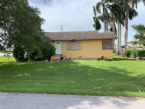 Photo of 317 NW Avenue I, Belle Glade, FL 33430 (MLS # RX-10638435)