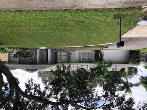 Photo of 10718 Locust Street, Palm Beach Gardens, FL 33418 (MLS # RX-10673435)