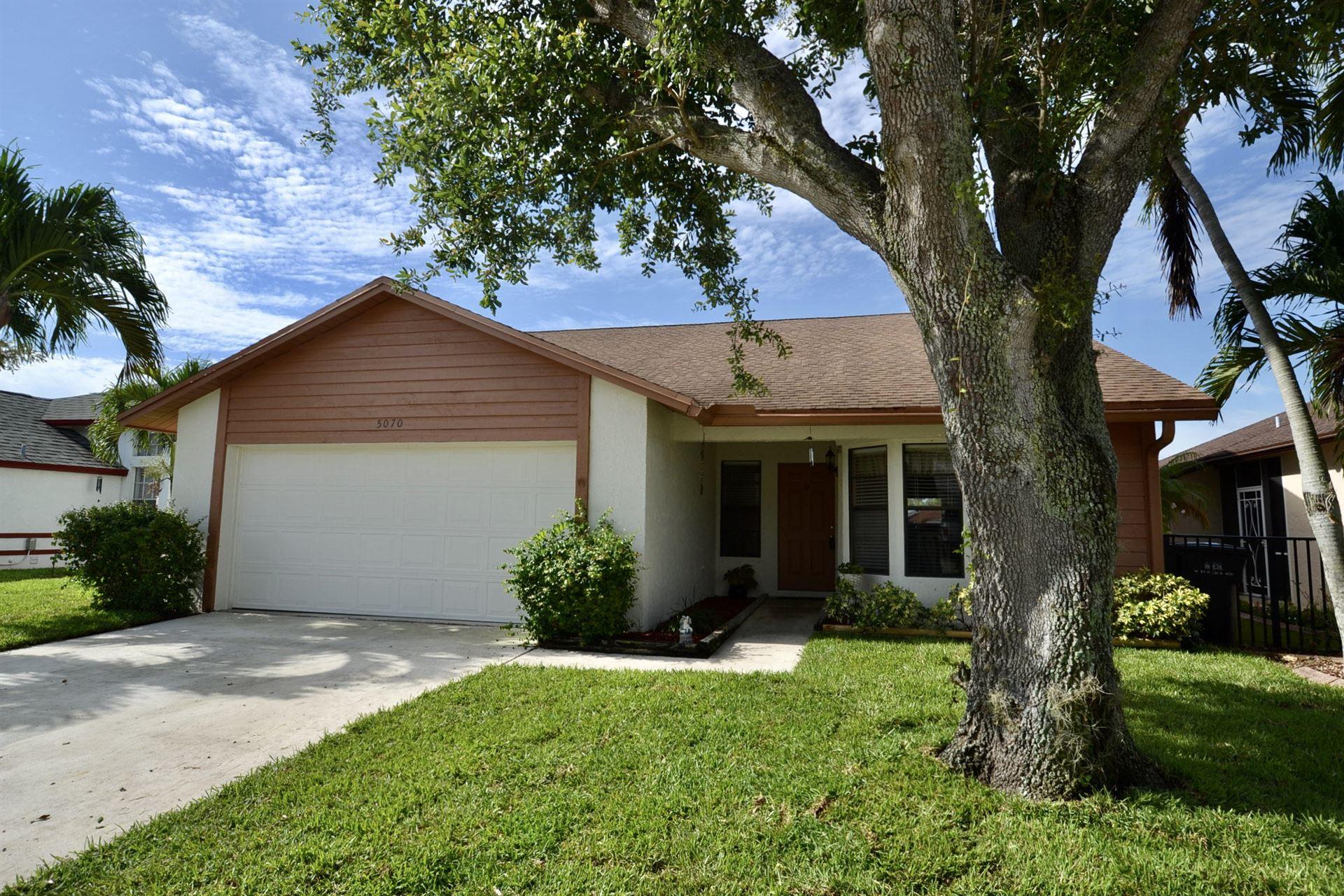 Photo of 5070 Foxhall Drive N, West Palm Beach, FL 33417 (MLS # RX-10715435)