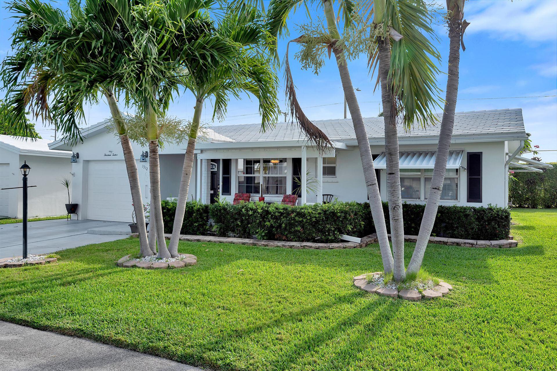 Photo of 1312 SW 24th Street, Boynton Beach, FL 33426 (MLS # RX-10715437)