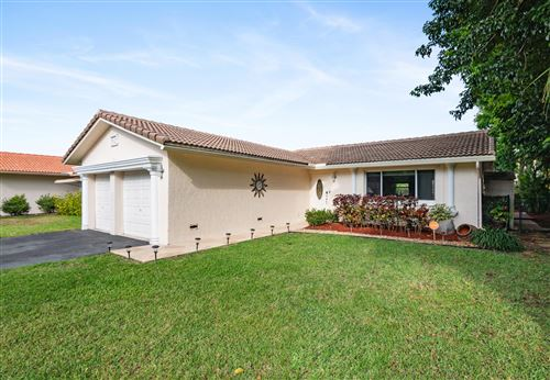 Photo of 745 NW 87th Avenue, Coral Springs, FL 33071 (MLS # RX-10617439)