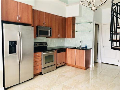 Photo of 801 S Olive Avenue #403, West Palm Beach, FL 33401 (MLS # RX-10733440)