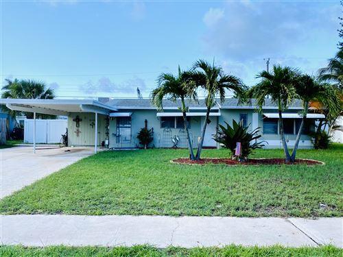Photo of 804 Cinnamon Road, North Palm Beach, FL 33408 (MLS # RX-10733441)