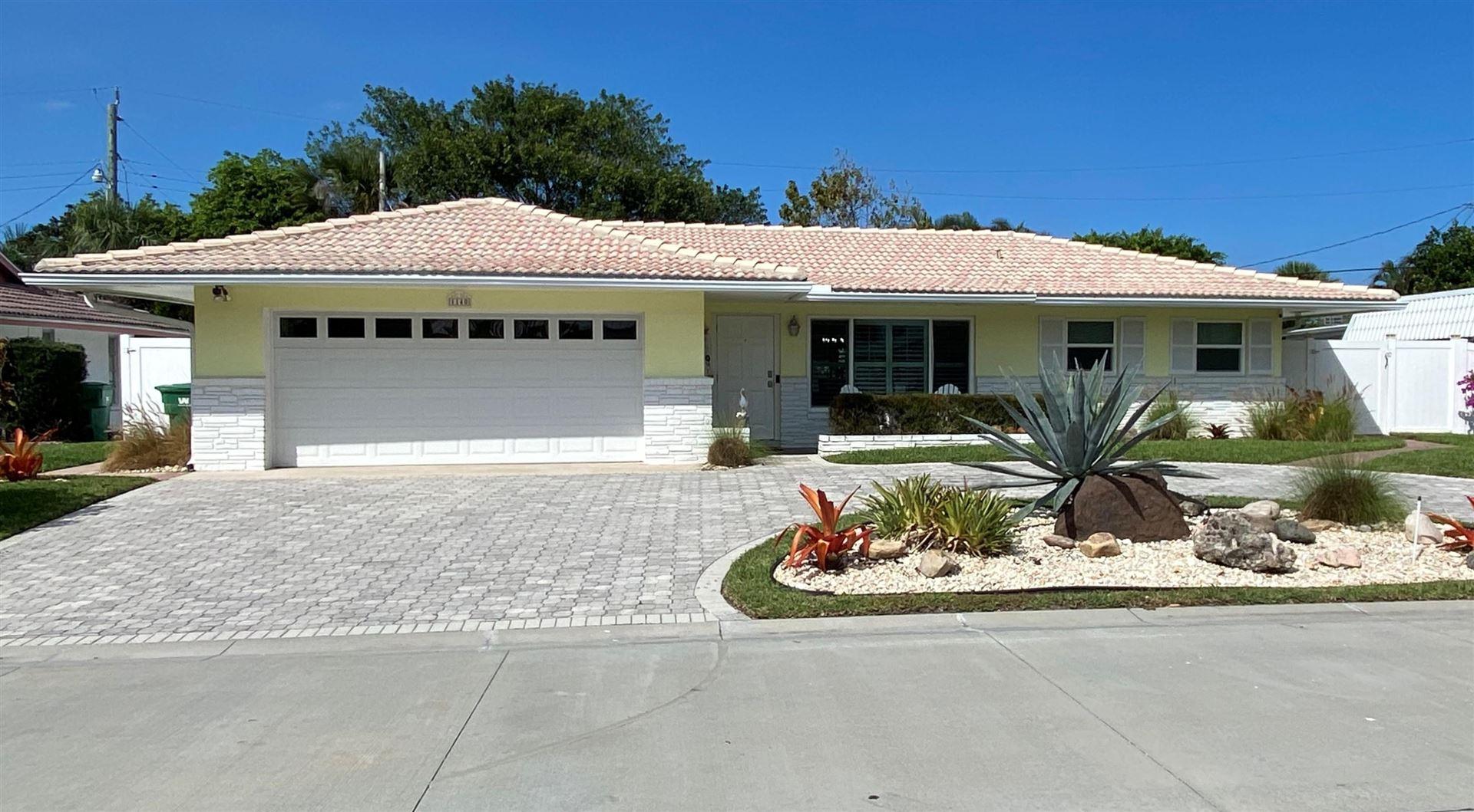 Photo of 1140 Singer Drive, Riviera Beach, FL 33404 (MLS # RX-10694442)