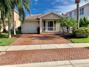 Photo of 5030 Starblaze Drive, Greenacres, FL 33463 (MLS # RX-10553445)