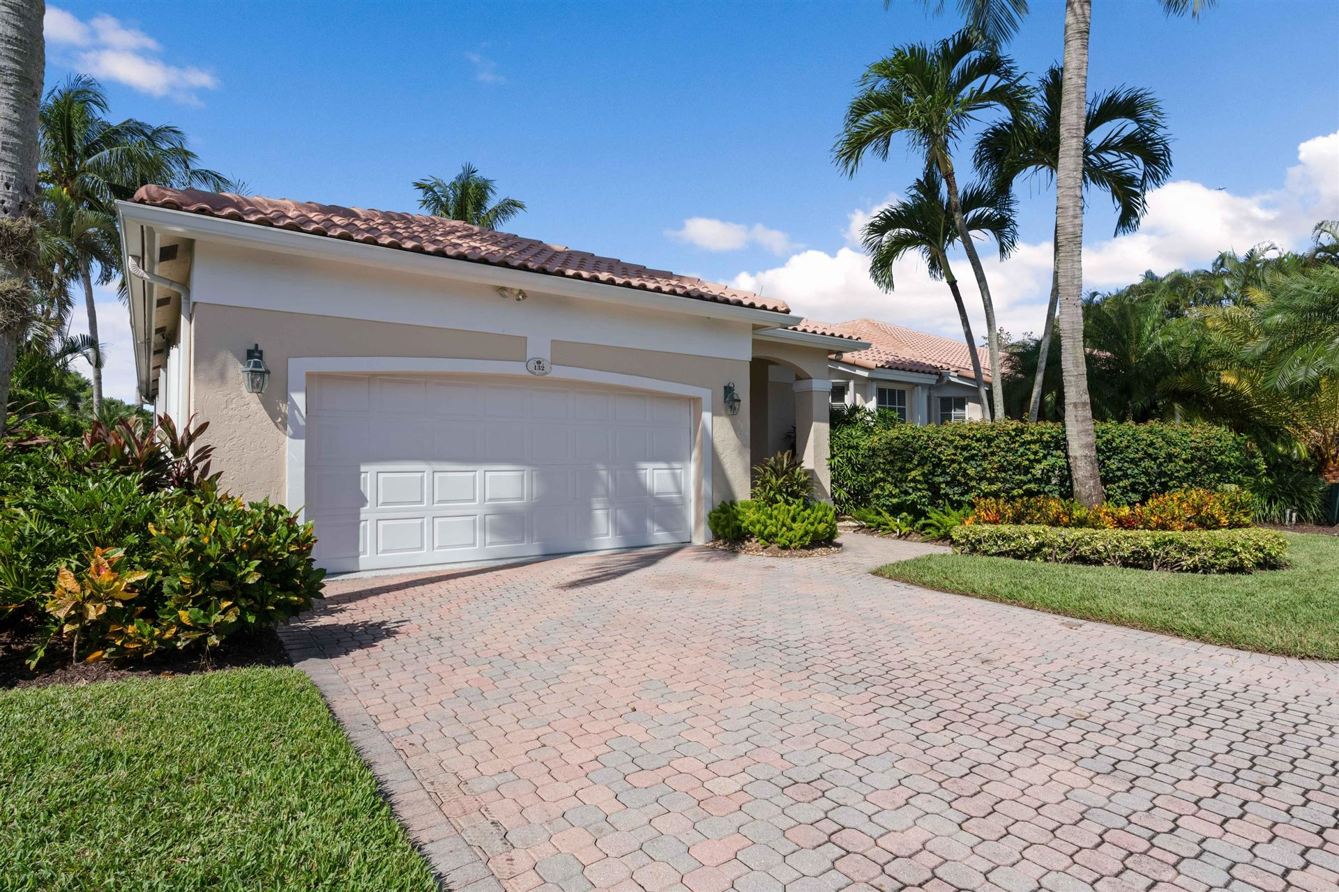 Photo of 132 Golf Village Boulevard, Jupiter, FL 33458 (MLS # RX-10666447)