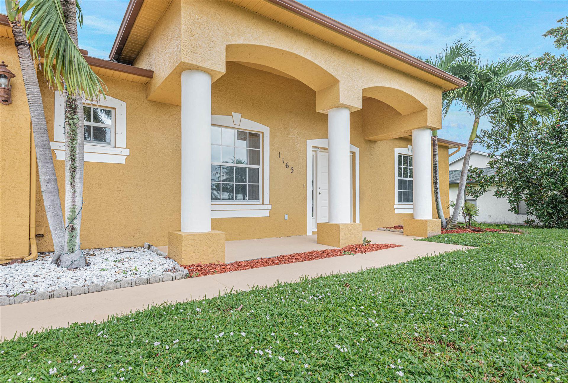 Photo of 1165 SE Menores Avenue, Port Saint Lucie, FL 34952 (MLS # RX-10658449)