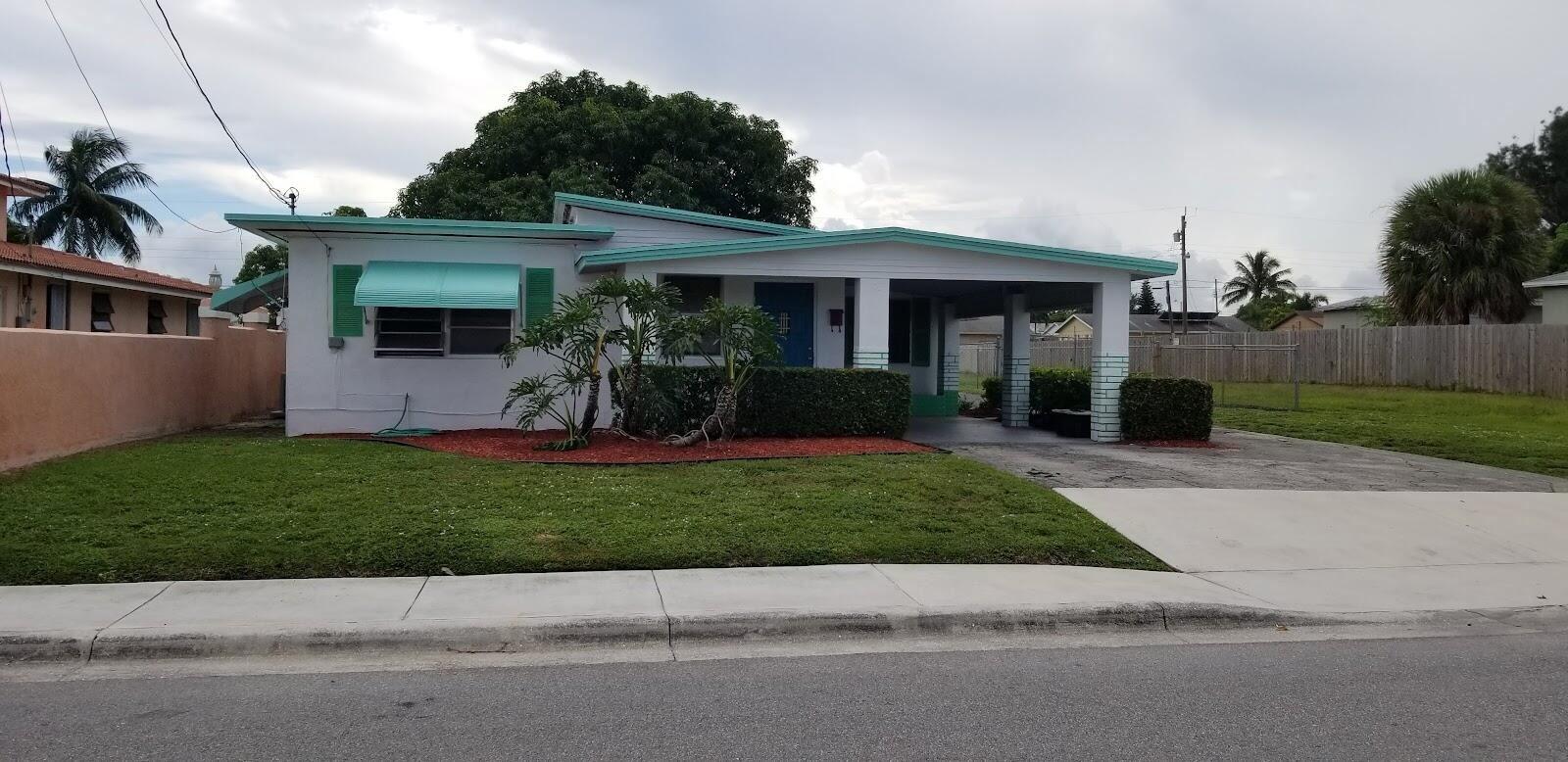 Photo of 1397 W 28th Street, Riviera Beach, FL 33404 (MLS # RX-10748449)