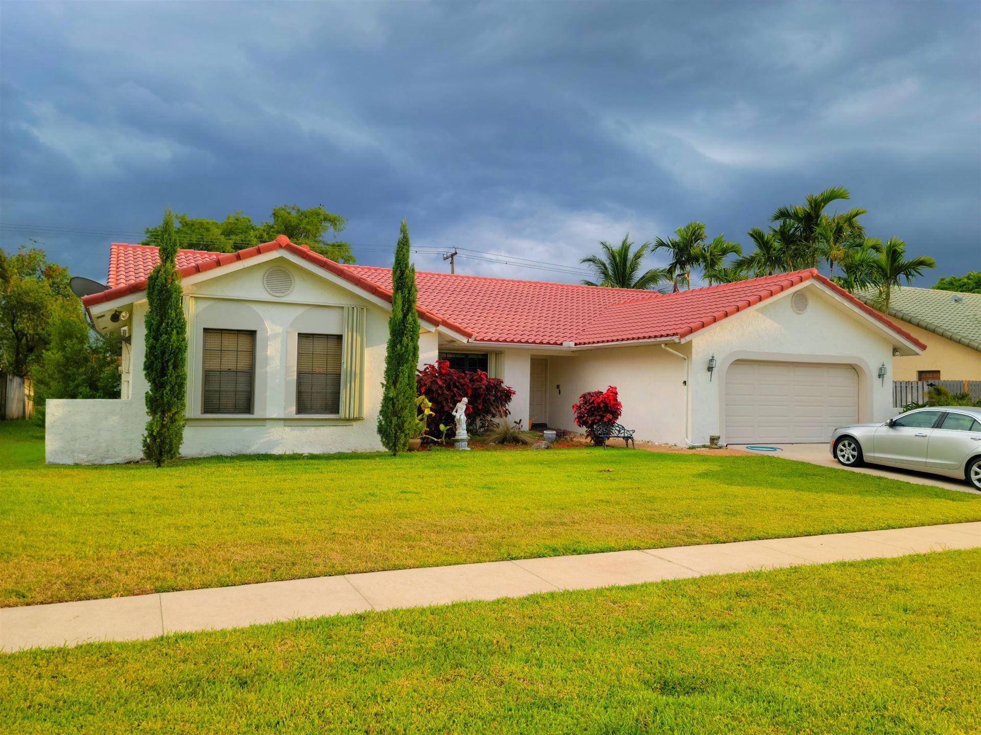 Photo of 22419 Martella Avenue, Boca Raton, FL 33433 (MLS # RX-10714451)