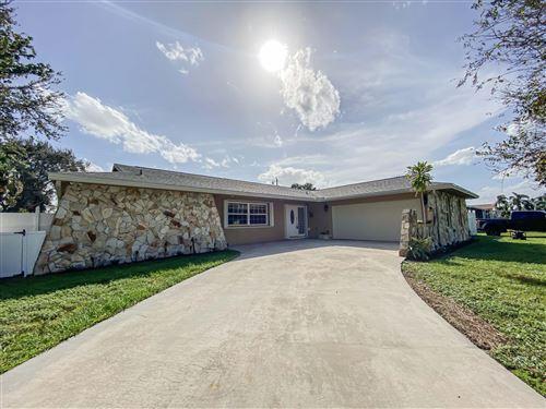 Photo of 109 W Pine Tree Avenue, Lake Worth, FL 33467 (MLS # RX-10754453)