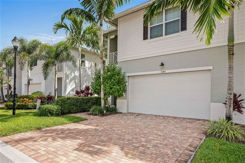 Photo of 1044 Piccadilly Street, Palm Beach Gardens, FL 33418 (MLS # RX-10570454)
