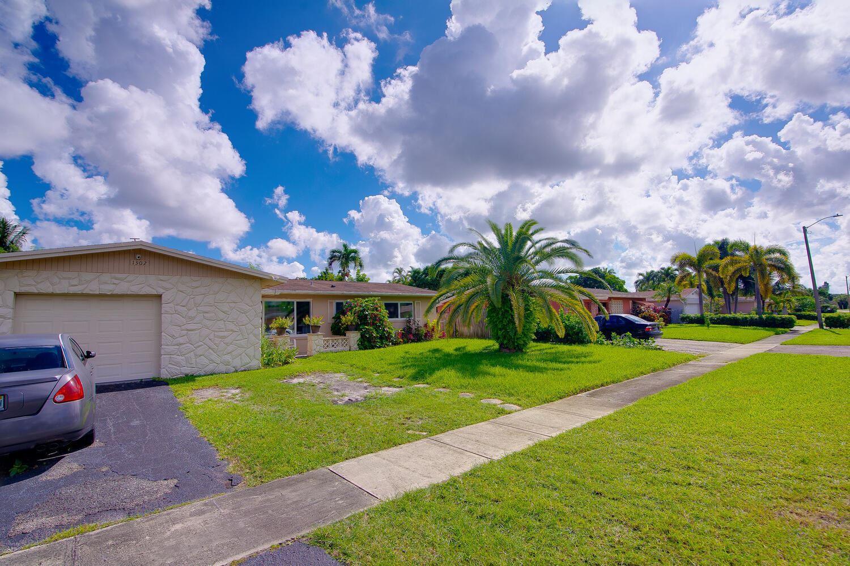 Photo of 1302 Braeburn, North Lauderdale, FL 33068 (MLS # RX-10752454)
