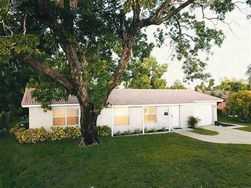 Photo of 7516 NW 42 Drive, Coral Springs, FL 33065 (MLS # RX-10632457)