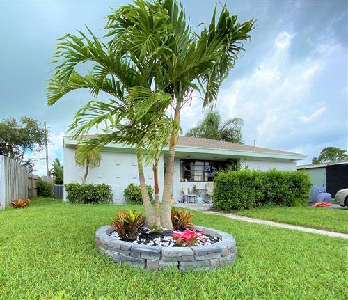 Photo of 839 Hibiscus Drive, Royal Palm Beach, FL 33411 (MLS # RX-10613461)