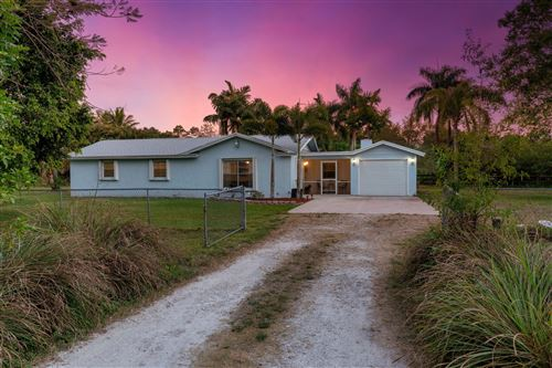 Photo of 14842 April Drive, Loxahatchee Groves, FL 33470 (MLS # RX-10612464)