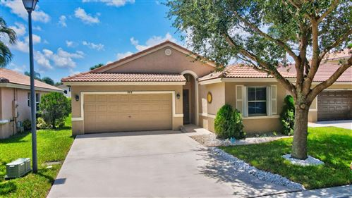 Photo of 5416 NW 50th Court, Coconut Creek, FL 33073 (MLS # RX-10645464)