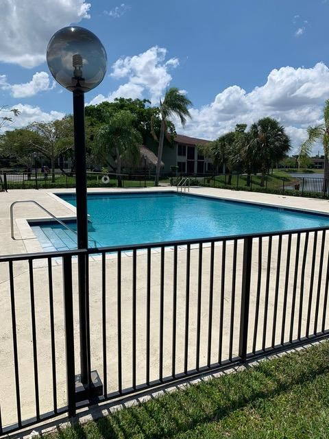 Photo of 215 Lake Pointe Drive #209, Oakland Park, FL 33309 (MLS # RX-10674475)