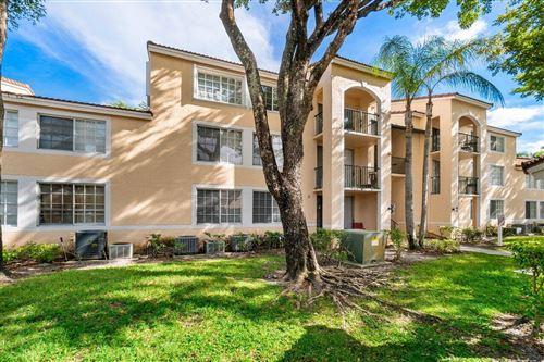 Photo of 1715 Village 103 Boulevard #103, West Palm Beach, FL 33409 (MLS # RX-10750477)