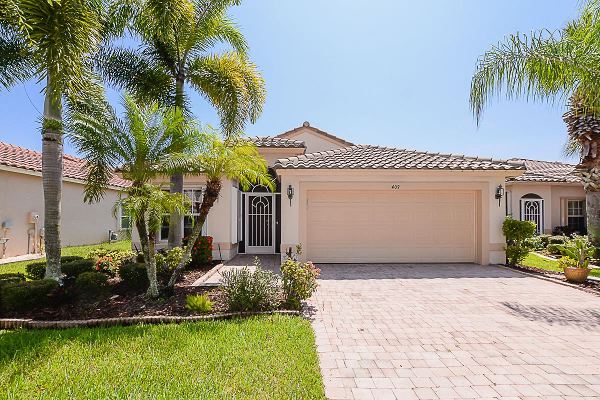 Photo of 409 NW Breezy Point Loop, Port Saint Lucie, FL 34986 (MLS # RX-10639478)