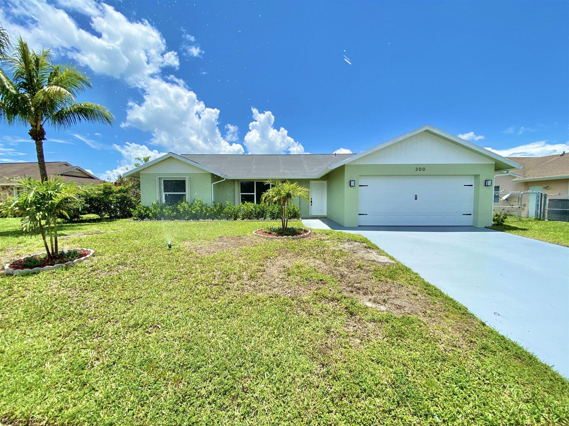 Photo of 300 La Mancha Avenue, Royal Palm Beach, FL 33411 (MLS # RX-10726482)