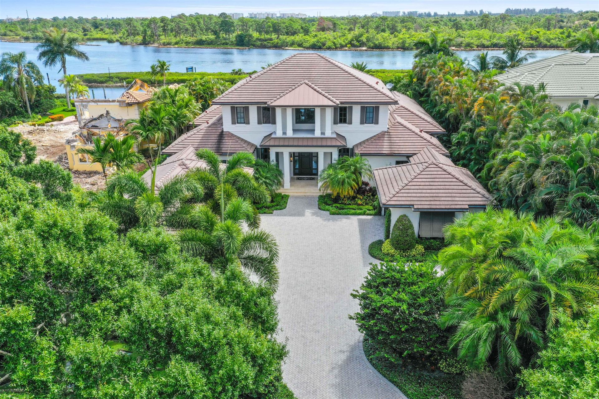 Photo of 225 Commodore Drive, Jupiter, FL 33477 (MLS # RX-10653488)