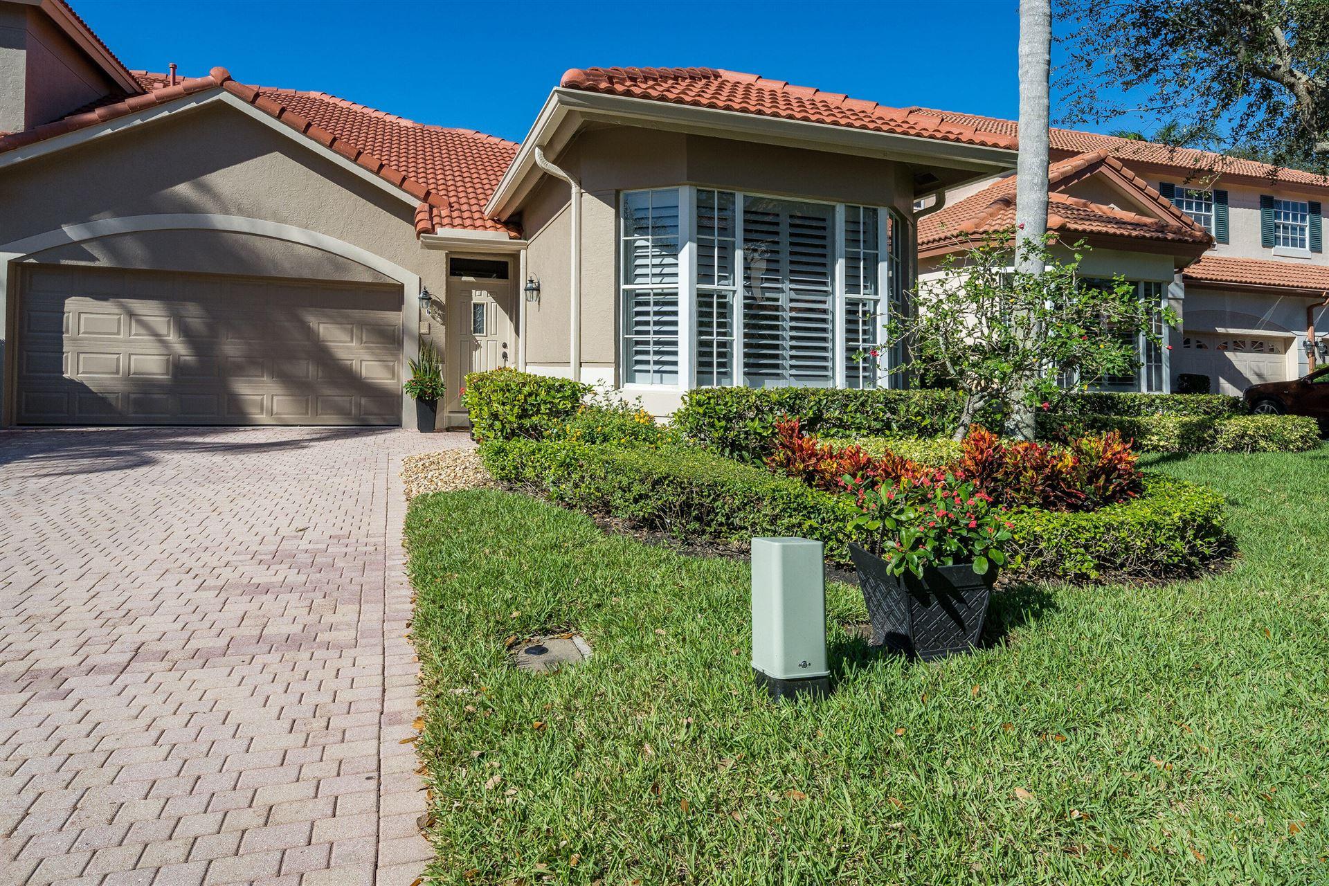 Photo of 65 Monterey Pointe Drive, Palm Beach Gardens, FL 33418 (MLS # RX-10675492)
