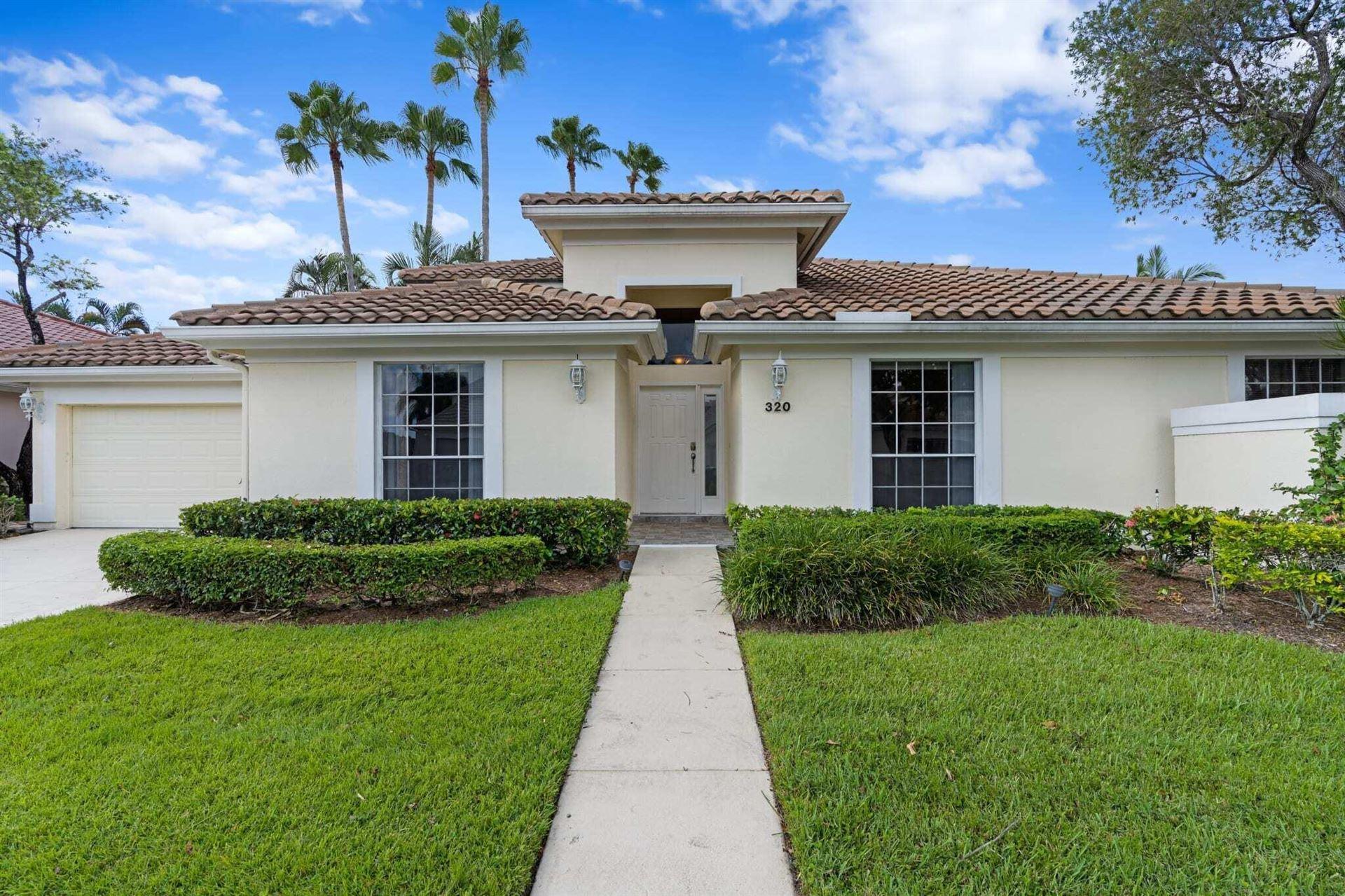 Photo of 320 Eagleton Golf Drive, Palm Beach Gardens, FL 33418 (MLS # RX-10741492)