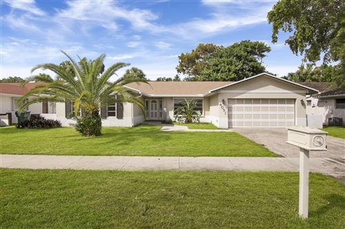 Photo of 4091 NW 19th Ter Terrace, Oakland Park, FL 33309 (MLS # RX-10667496)